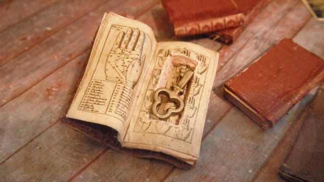 l delaney miniature books secret compartment